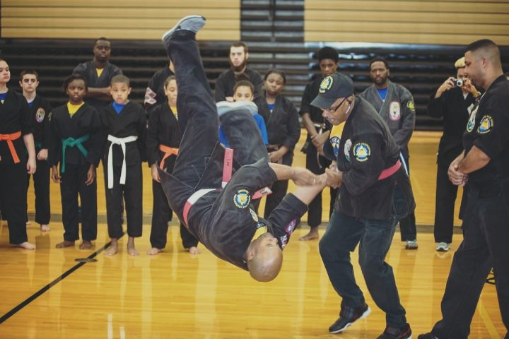 Grandmaster demonstrate technique with Sensei Melbert Lee Jr. to K-5 Students