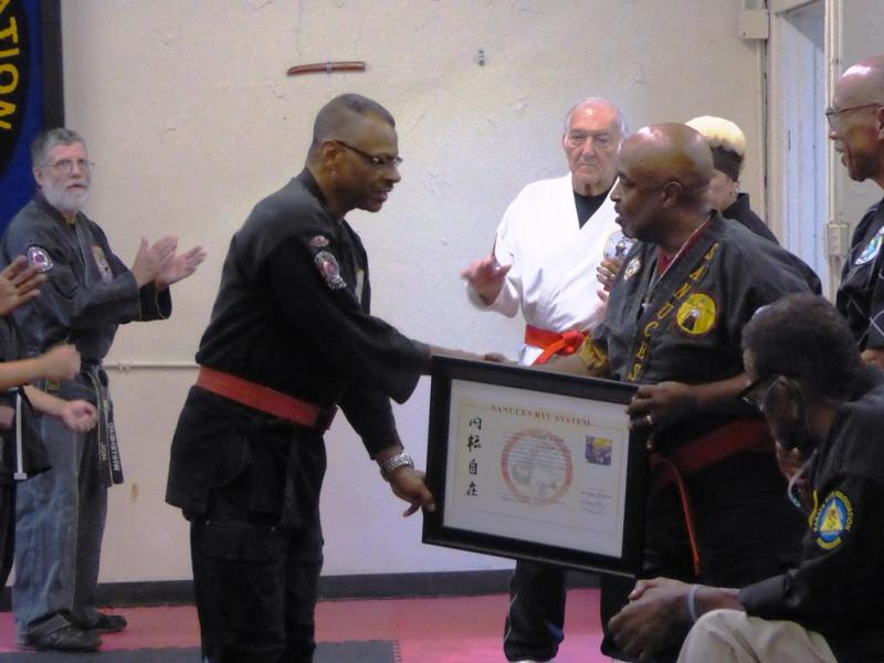 Grandmaster Willie Wilson receiving Certificate for 10th Dan
